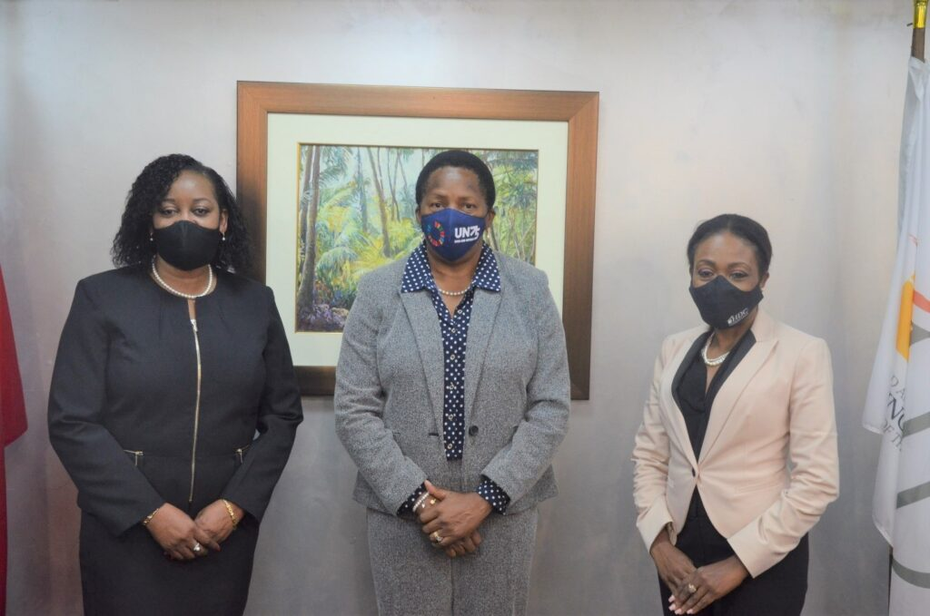 Minister Beckles center, with Claire Davidson-Williams, Permanent Secretary and Ms. Jayselle McFarlane, newly-appointed Managing Director of the HDC.